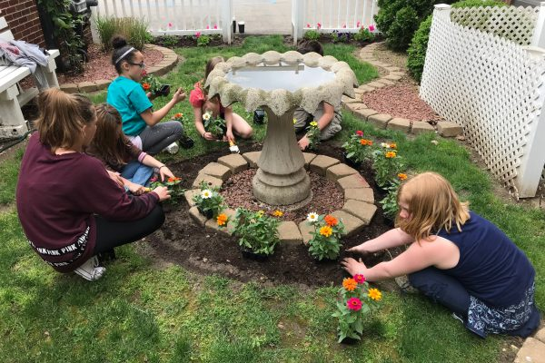 Beautifying spaces is one activity that strong neighborhoods often do. (Photo Courtesy Boys & Girls Club)