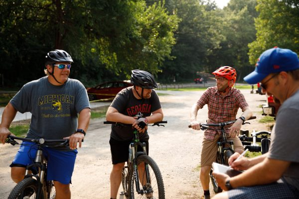 Writer Marshall V. King (right) interviews mountain bikers at Bonneyville Mill County Park in summer 2018. (Photo by Grant Beachy)